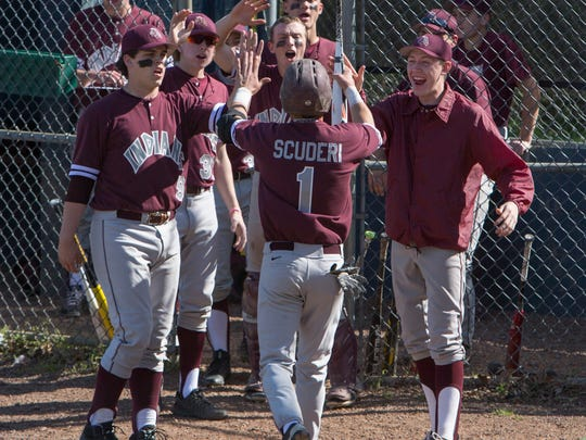 Toms River South's TJ Scuderi gets high fives all around after scoring his team's second run of game in 3-2 win over Brick Memorial. Toms River South baseball vs Brick Memorial in OCT semifinal game in Brick, NJ on May 12, 2016.