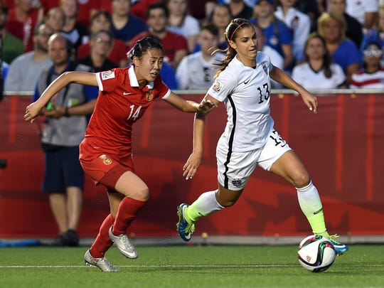 United States forward Alex Morgan (13) controls the ball against China forward Zhao Rong (14) during the second half in the quarterfinals of the FIFA 2015 Women's World Cup at Lansdowne Stadium.