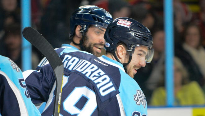 Milwaukee Admirals center Frederick Gaudreau celebrates his empty-net goal to close out the scoring in a 5-2 victory over the Rockford IceHogs on Friday at the UW-Milwaukee Panther Arena.