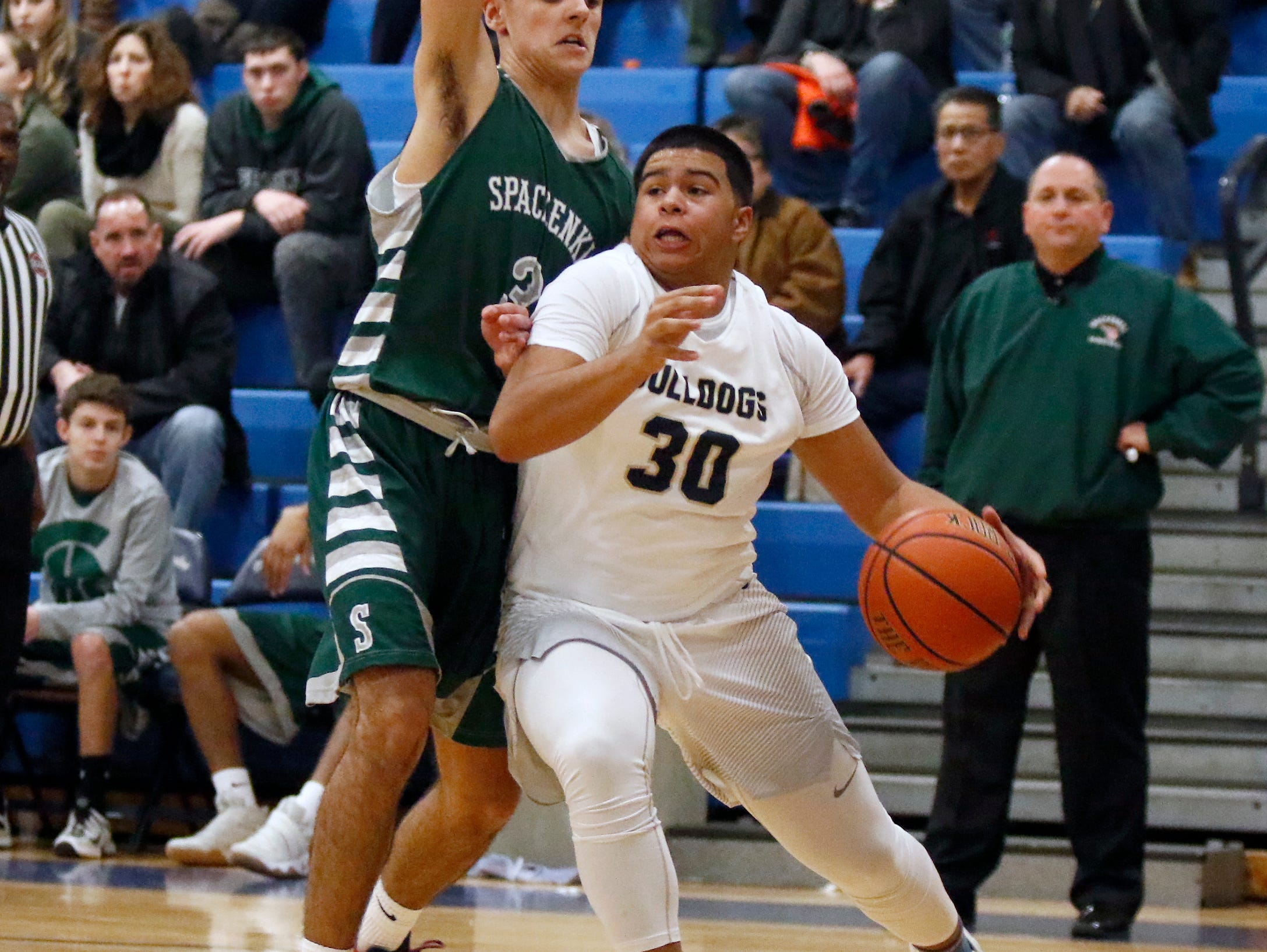 Beacon's Andre Davis (30) drives the baseline against Spackenkill's Haden Peek (3) in the championship game of the Duane Davis memorial basketball tournament at Our Lady of Lourdes High School in Poughkeepsie on Saturday, December 31, 2016.