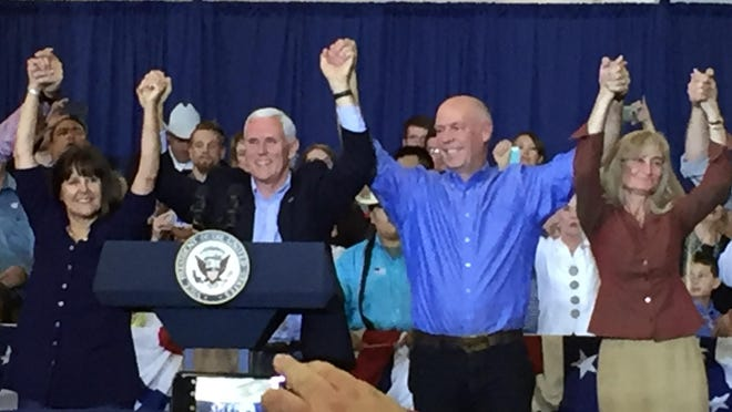 Vice President Mike Pence, left, stands Friday with congressional candidate Greg Gianforte at MetraPark in Billings.