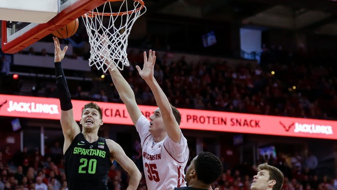 Michigan State's Matt McQuaid shoots against Wisconsin's Nate Reuvers during the first half Sunday, Feb. 25, 2018, in Madison, Wis.