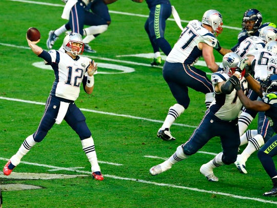 Patriots QB Tom Brady throws the ball during the first quarter of Super Bowl XLIX at University of Phoenix Stadium in Glendale on Feb. 1, 2015.