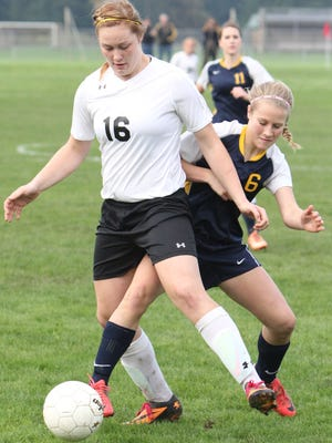Cascade's Halle Wright defends the ball against Banks' Kayla Schnaubelt in the Cougars' 2-1 win on Saturday, Nov. 8, 2014.