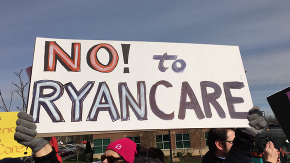 A sign protesting a bill to repeal-and-replace Obamacare,