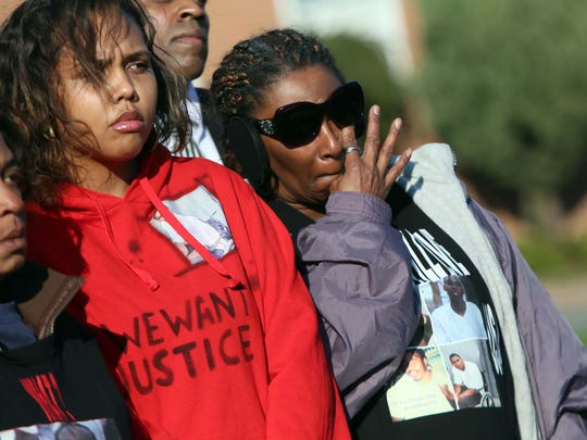 "Left to right, sister of Jeremy ""Bam"" McDole, Corina Gross stands next to family friend Lavern Mills, as she wipes away tears at a press conference demanding that Police Chief Bobby Cummings immediately resign.  McDole was shot and killed in an encounter with police officers responding to a report of a man who had shot himself."