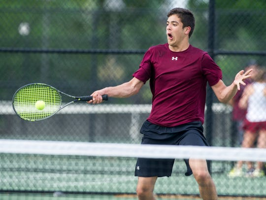 Henderson County junior Jon Nunez rallies with Caldwell County's Ben Knight in the Second Region boys singles finals at the Doc Hosbach Tennis Complex in Henderson, Ky., Wednesday, May 9, 2018. Nunez lost to Knight 6-2, 7-5.