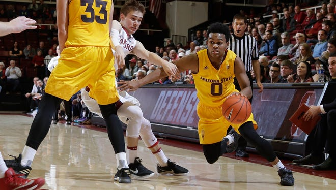 ASU guard Tra Holder (0) dribbles past Stanford guard Robert Cartwright, center, on a screen from Ramon Vila (33) during the first half, Friday, Dec. 30, 2016, in Stanford, Calif.