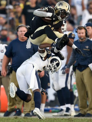 New Orleans Saints running back Alvin Kamara, top jumps over Los Angeles Rams cornerback Kayvon Webster during the second half of an NFL football game, Sunday, Nov. 26, 2017, in Los Angeles. (AP Photo/Kelvin Kuo)