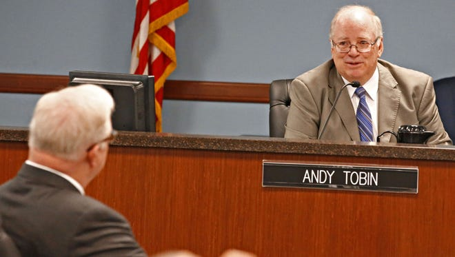 Two Democrats are asking Andy Tobin to resign from the Corporation Commission.