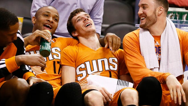 March 1, 2014 - Suns Goran Dragic falls into his teammates on the bench after scoring a career high 40-points against the New Pelicans.