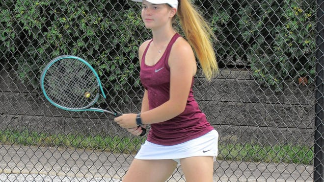 Freshman Elizabeth Campbell of the New Albany girls tennis team awaits a shot during a second-doubles match in a 4-1 victory over visiting Watterson on Aug. 12. The Eagles, who won 13 OCC-Capital Division championships in the past 14 years, have moved to the OCC-Ohio.
