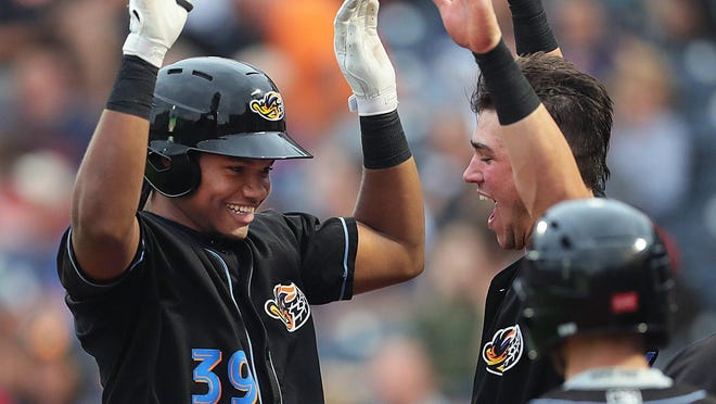Akron RubberDucks Oscar Gonzalez (39) is congratulated as he enters the dugout after hitting a three-run homer during the second inning of a baseball game against the Trenton Thunder at Canal Park, Tuesday, Aug. 13, 2019 in Akron, Ohio. [Jeff Lange/Beacon Journal/Ohio.com