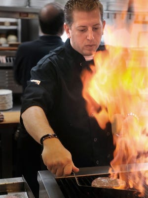 Chef George Kyrtatas mans the grill at SweetWater Bar & Grill in Cinnaminson.