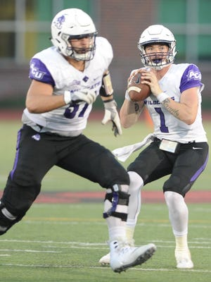 ACU quarterback Dallas Sealey, right, looks to throw the ball while Brady Melde blocks. The Wildcats beat Incarnate Word 45-20 in the Southland Conference game Saturday, Sept. 30. 2017 in San Antonio.