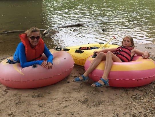Amanda Kingsbury and her daughter, Violet, went tubing