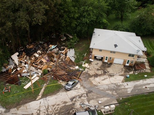 A home in Urbandale that exploded during the flash flooding Saturday night is seen the morning after on Sunday, July 1, 2018. Everyone in the home made it out.
