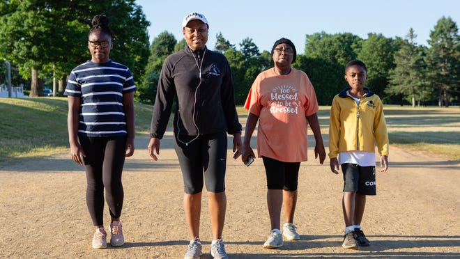 Regine Muteck of Worcester walks on the track of Quinsigamond Community College at 6 a.m. every day with her mother Claire, her daughter Marilyn, 13, and her son, Engelbert, 10. The family has been walking together since early April.