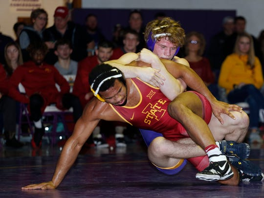 Northern Iowa's Jacob Holschlag, top, dominates Iowa State's Sam Colbray in the 197 pound match in a Big 12 wrestling dual at the West Gym Saturday, Feb. 10, 2018, in Cedar Falls, Iowa.