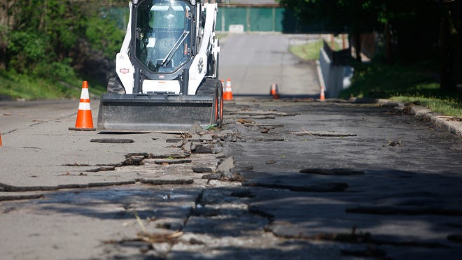 Spring Street in Avon on Tuesday after more than 6 inches of rain fell on the community on Sunday and Monday. The road will be fixed by Monday.
