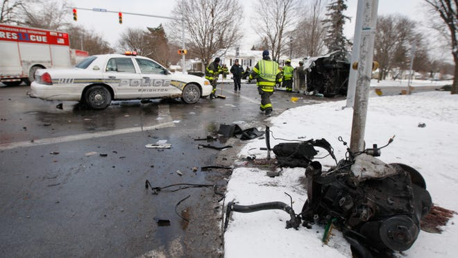 Mail and vehicle parts were scattered around the intersection of South Winton Road and Highland Avenue.
