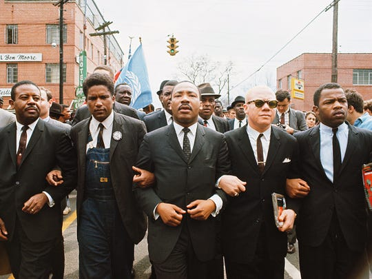 This famous photo is often identified as the Rev. Martin Luther King Jr. leading the 1965 Voting Rights March from Selma to Montgomery, but it is actually from student protests in Montgomery days before the march. From left to right: The Rev. Ralph David Abernathy Sr., the Rev. Jesse Douglas, King, James Forman and John Lewis.