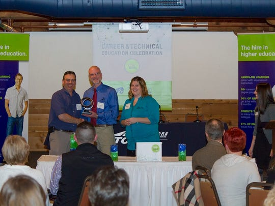 Jagemann Stamping HR Manager Jim Trost, left, accepts his Top Tech Award from Rick Conrad and Kari Mueller, of Manitowoc Youth Apprenticeship, at the Lakeshore Culinary Institute in Sheboygan.
