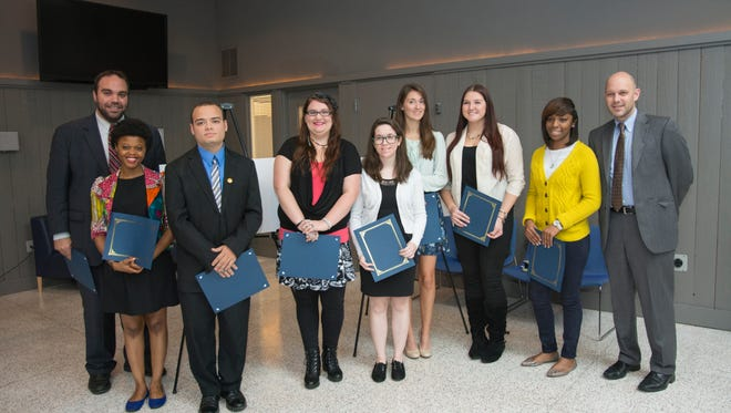(L-R) Tom Southard, director of the Wolfington Center at Cabrini College; Karina Dean; Michael Burrell; Alicia Ireland; Caroline McCarthy; Molly McDougall; Courtney McGonigle; Amina Smith; and Jeff Gingerich, Ph.D., provost and vice president for Academic Affairs.