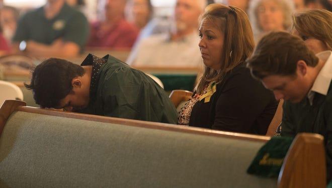 A Santa Fe High School senior becomes emotional during a service at Arcadia First Baptist Church in Santa Fe, Texas on May 20, 2018.