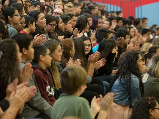 The Student body of Lynn Middle School clap as National NEA President Lily Eskelsen-Garcia as she them about meeting with President Obama and reporting to him about Lynn being the first Community school in Las Cruces, Thursday, January 19, 2017.