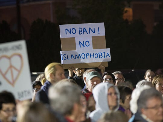 Muslims, Jews, Christians, gay and straight Las Crucens gathered Tuesday, Jan. 31, 2017, in front of the Islamic Center of Las Cruces to protest the recent travel ban and temporary suspension of the U.S. refugee program by the Trump administration.