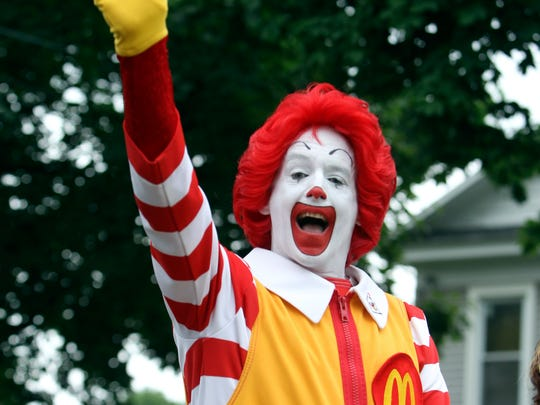 Ronald McDonald waves at the Boxing Hall of Fame parade in Canastota, N.Y., on June 12, 2011.