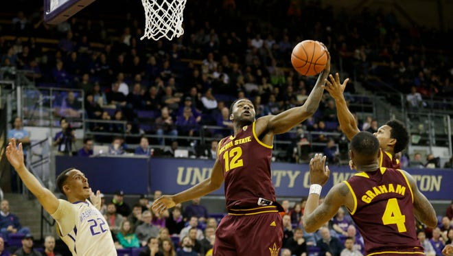 Arizona State forward Andre Adams (12) grabs a rebound during the first half of the team's NCAA college basketball game against Washington, Thursday, Feb. 16, 2017, in Seattle.