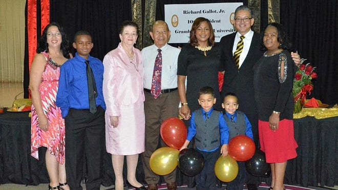 """Grambling State University President Rick Gallot Jr., second from right, and his family were honored Aug. 3 at New Living Word Ministries. Pictured are, from left, sister Daphne Gallot-Knighten, son """"AJ"""" Thomas, mother Mildred Gallot, father Rick J. Gallot Sr., wife Christy, Gallot, mother-in-law Cassandra Cox and in front, sons Christopher and Joseph Gallot."""
