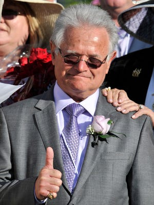 Art Sherman the trainer for California Chrome celebrates in the winner's circle after the 2014 Kentucky Derby at Churchill Downs. The owners of the horse were offered $6 million prior to the Derby and Sherman thinks the horse has entered a new tax bracket now.
