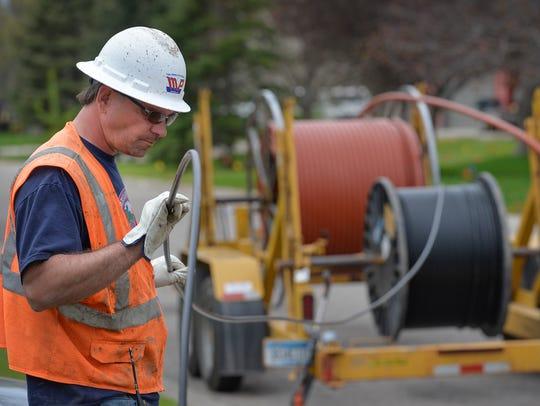 Joel Hendrickson, a worker from MP Nexlevel, watches