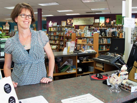 Books & Company owner Lisa Baudoin, her staff and Llama