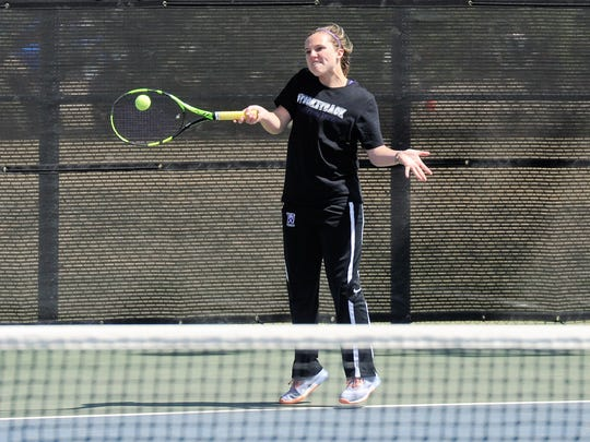 Wylie's Andrea McMillan lines up a shot during the Region I-4A girls doubles final at Texas Tech's McLeod Tennis Center on Thursday, April 19, 2018. McMillan and Elle Schroeder dropped the championship match, but won 6-2, 6-0 in the playback to finish second and qualify for state.