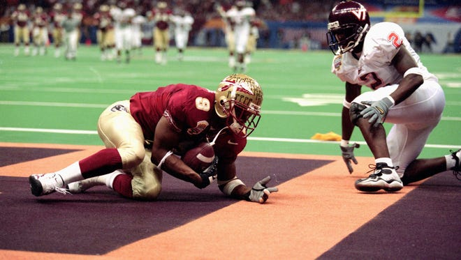 Florida State wide receiver Peter Warrick makes a touchdown during the Nokita Sugar Bowl Game against the Virginia Tech Hokies at the Louisiana Superdome in New Orleans, Louisiana, on Jan. 5, 2000. The Seminoles defeated the Hokies 46-29.