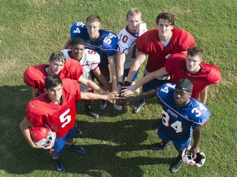 Clockwise from left: Scott Marshman (5), Riley Fields (56), Tony Gibson (5), Spencer Hill (54), Jaxon Adams (10), Bailey Clark (2), Cameron Bozeman, and Anthony Johnson (34) during Pace High School football practice on Wednesday, August 3, 2016.