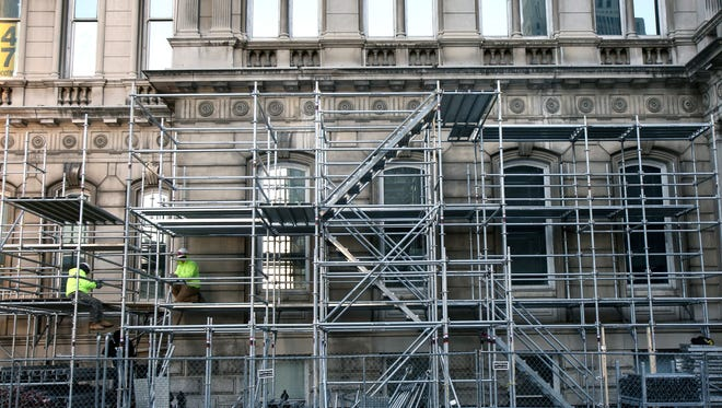 Scaffolding is going up around City Hall for a preservation project getting underway.