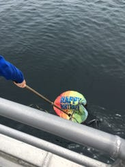 Island Packers crews pull a couple hundred balloons