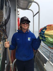Crew member Taylor Robinson poses with the balloon