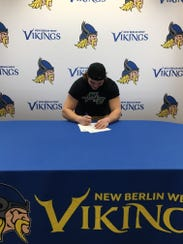 New Berlin West's Tony Gress signs to play football