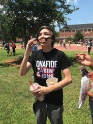 UL students observe the solar eclipse Monday.