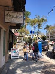 Shoppers stroll Main Street in downtown Ventura.