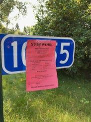A stop work order marks Michael Nwachukwu's Watab property