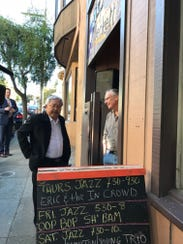 San Francisco Mayor Ed Lee chats with Eric Whittington, owner of Bird and Beckett bookstore in San Francisco, on Nov. 30, 2017.
