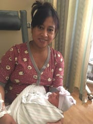 Elena Moran holds her hours-old daughter at Community