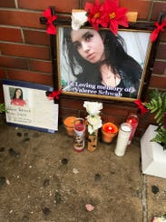 A memorial was set up outside the Dunkin' Donuts in